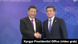 Кытайдын лидери Си Цзинпин менен Кыргызстандын президенти Сооронбай Жээнбеков, Бишкек, 14-июнь 2019-жыл.