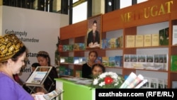 A portrait of the Turkmen president looms over attendees of the international book fair in the capital, Ashgabat.