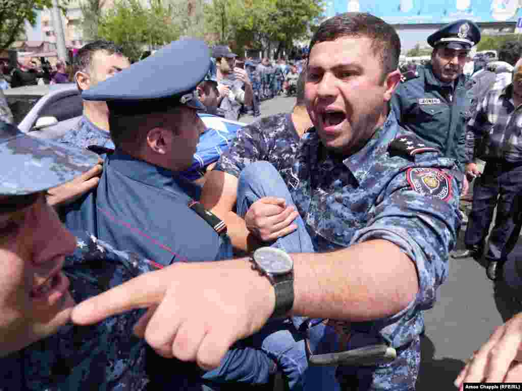 More than 100 protesters were detained in downtown Yerevan after scuffles with riot police that had cordoned off a major government building on April 19 -- the seventh day of street protests against the election of longtime former President Serzh Sarkisian as prime minister. (Amos Chapple/RFE/RL)