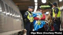 Беженцы из Сирии на вокзале в Стокгольме