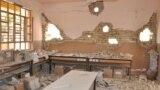 أضرار في مبنى بالفلوجة جراء القصف والمواجهات بين القوات الأمنية والمسلحين.