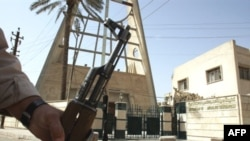 A security guard stands in front of the Syrian Catholic Church in Baghdad's district of Karrada.