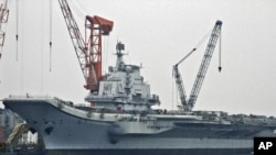 "China had long refused to acknowledge its work at Darian on the aircraft carrier known in Ukraine as the ""Varyag,"" seen here in an April 2011 photograph from northeastern China."