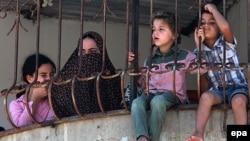 Палестинские дети в лагере беженцев в городе Хан-Юнис, 9 июля 2014 г.