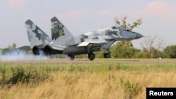 A Ukrainian Mikoyan MiG-29 jet fighter lands in the northwestern Rivne region during military aviation drills amid an uptick in tensions between Ukraine and Russia.