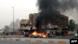 Bombings such as this car bomb in Talibiya in Baghdad are standard procedure in Sunni-Shi'ite violence (file photo)