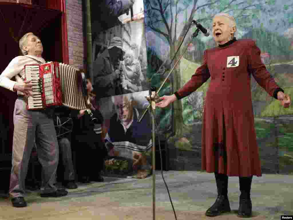 "Tsiuri Kakabadze (right), 80, performs during the ""Super Grandmother and Super Grandfather"" contest in Tbilisi on January 5. Twenty-four participants aged over 70 from all over Georgia attended the contest. Photo by David Mdzinarishvili for Reuters"