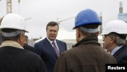 Ukrainian President Viktor Yanukovych with construction workers in Lviv in late May