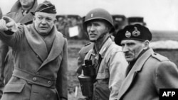 France -- Supreme Commander of the Allied Forces, General Dwight D. Eisenhower shows the strain of his command as he and Britain's Field Marshal Bernard Montgomery, his deputy commander, confer on the invasion plans of Normandy, 06Jun1944
