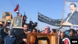 На родине Саддама Хусейна в Тикрите около 2000 тысяч иракцев вышли на демонстрацию протеста против казни бывшего глава государства.