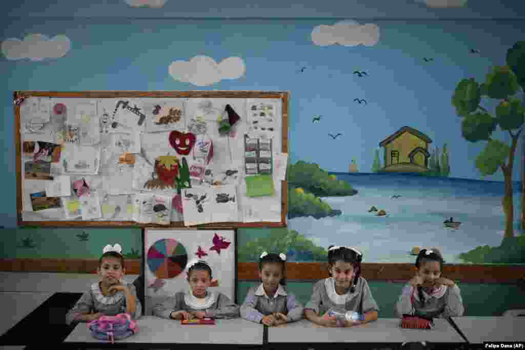 Girls sit inside a classroom during the first day of a new school year in Gaza City. Hundreds of thousands of Palestinian children are starting their school year in the Gaza Strip amid a major budget crunch for the United Nations agency that funds many schools. (AP/Felipe Dana)​