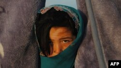 A child at a camp for returning refugees in Qala-e Qul Mohammad on the outskirts of Mazar-e Sharif, Afghanistan, in April