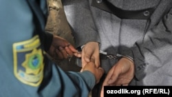 Uzbekistan - handcuffs, Uzbek police is detaining accused man, where?, 27Feb2012