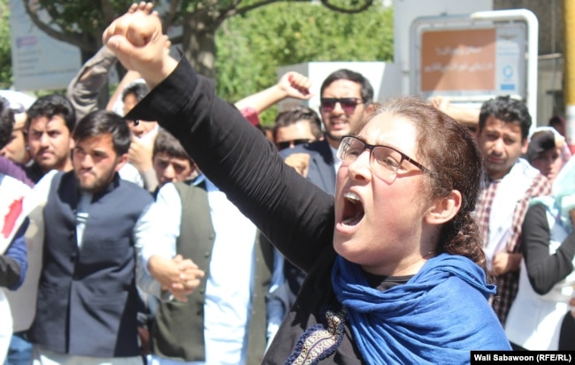 An Afghan woman shouts during a demonstration against President Ashraf Ghani's government on June 2.
