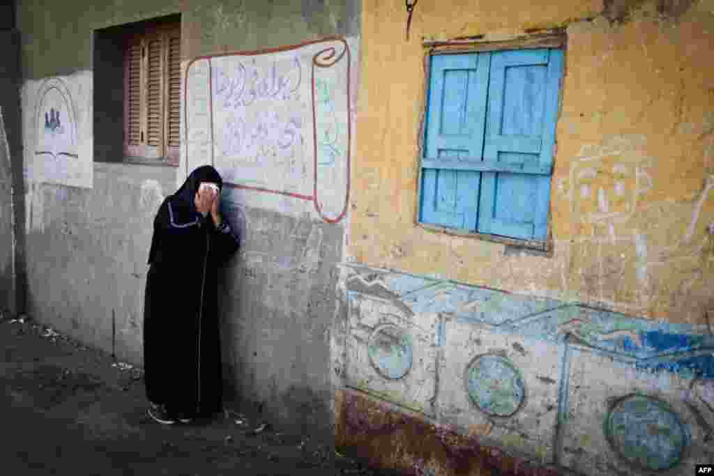 A relative of one of the Egyptian Coptic Christians purportedly murdered by Islamic State militants in Libya reacts after hearing the news in the village of Al-Awar in the southern province of Minya on February 16. (AFP/Mohamed El-Shahed)