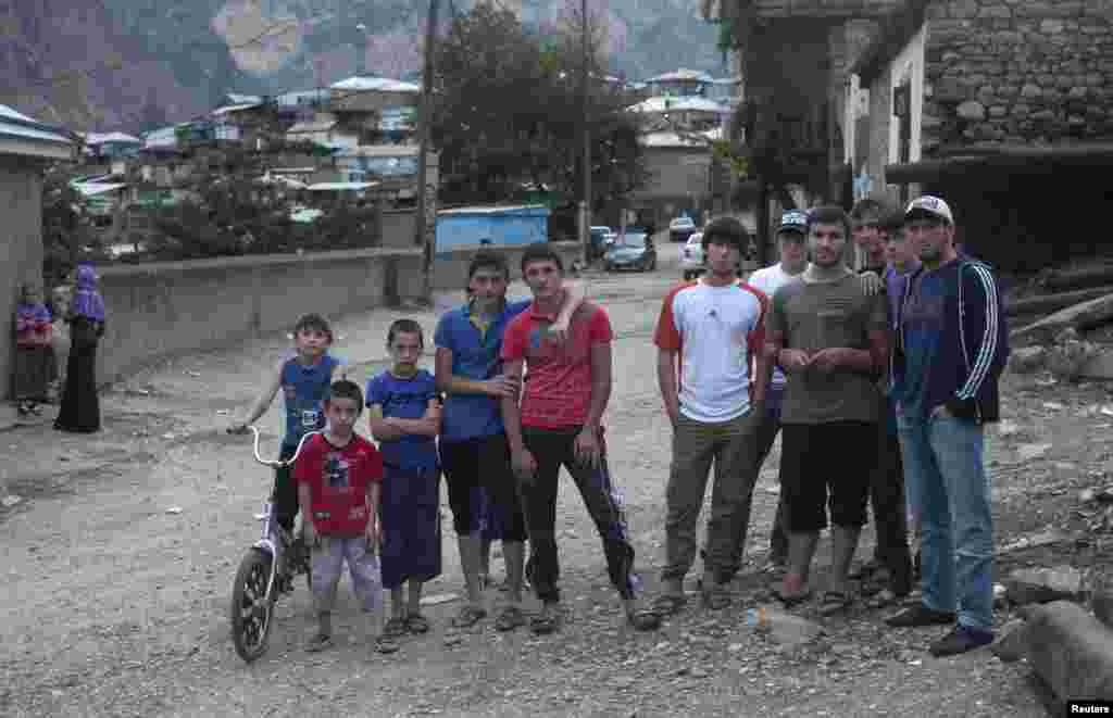 Young men and boys pose for a street picture in Gimry.