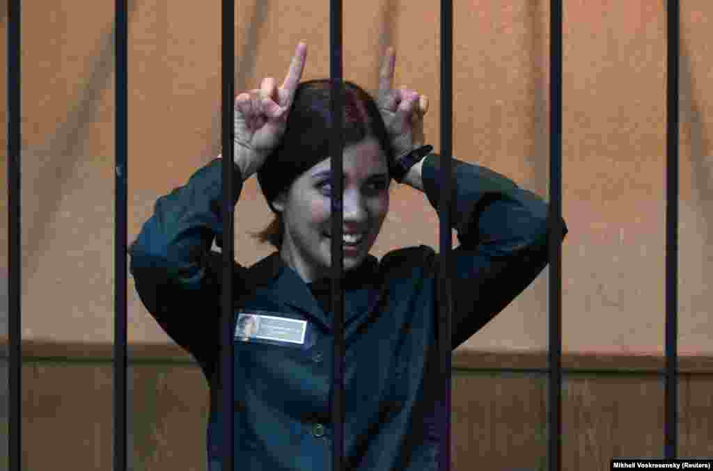 Nadezhda Tolokonnikova, a member of the Pussy Riot activist group, gestures during a court hearing in the town of Zubova Polyana on April 26. Tolokonnikova served a part of a two-year sentence on charges of hooliganism and was released in December.