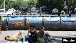 Armenia - Protesters sit and lie on the ground behind a barricade built on Marshal Bagramian Avenue, Yerevan, 29Jun2015.