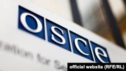 Emblema OSCE.