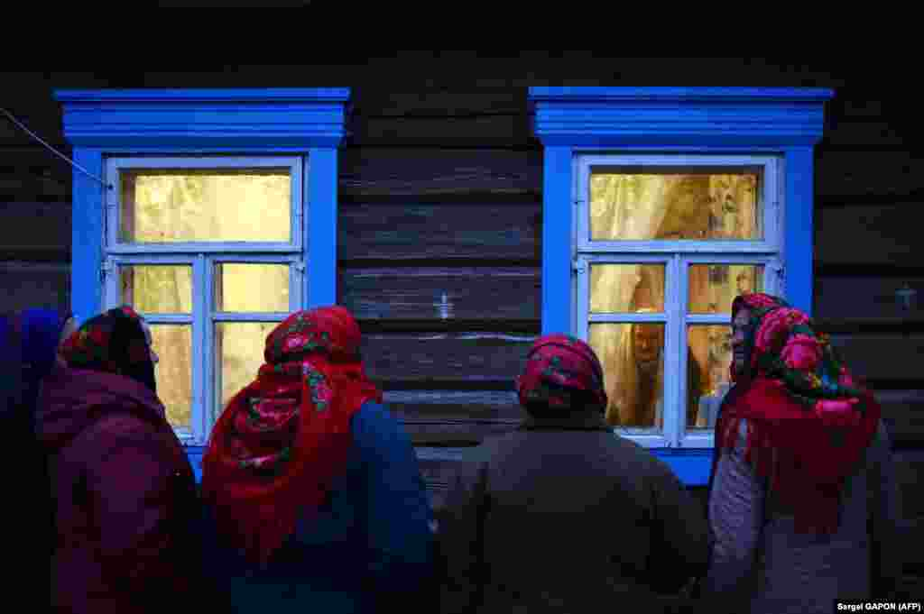 Belarusian villagers sing Christmas carols in the village of Danilevichy, some 320 kilometer south of Minsk, on January 7. (AFP/Sergei Gapon)