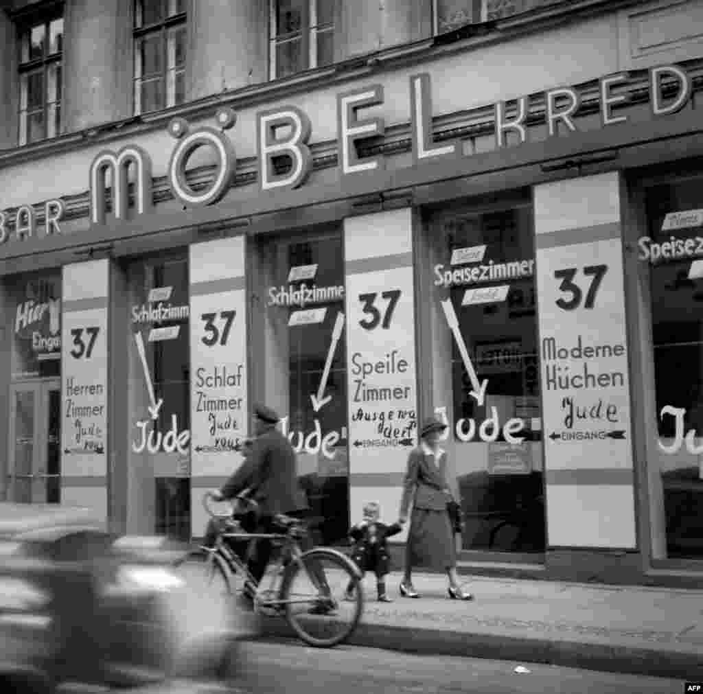 "A Jewish-run shop in Berlin with the word ""Jude"" or ""Jew"" painted on its windows, November 10,1938."
