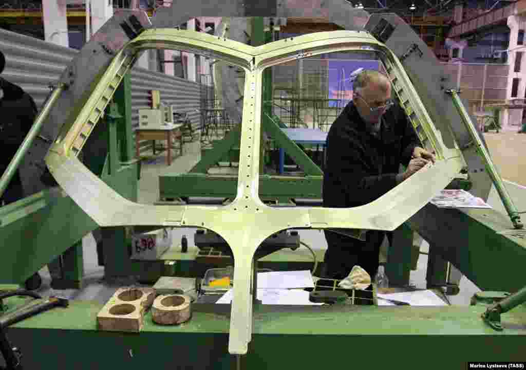 The distinctive cockpit window frame of the Superjet being assembled. The Russian government would eventually fund some 25% of the reported $1.4 billion spent on development of the jet, intended primarily for use as a regional passenger plane.
