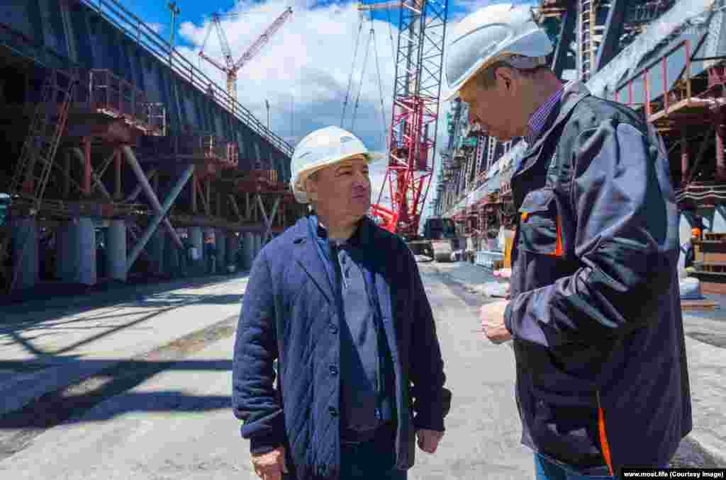 Arkady Rotenberg (center) visits the construction site. The construction magnate won the multibillion-dollar contract to build the bridge in 2015. Rotenberg is a childhood friend of Vladimir Putin and has amassed enormous personal wealth, mostly through construction contracts awarded by the Russian state. He was sanctioned by the European Union and the United States for his role in the Ukraine crisis.