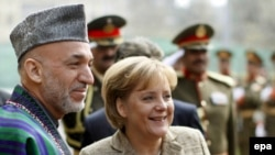 Afghan President Hamid Karzai and German Chancellor Angela Merkel (file photo)