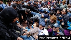 Kazakh police detain people in a square in the center of Almaty on June 9.