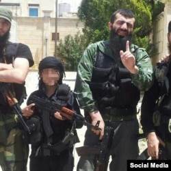 The 12-year-old son of Chechen militant Seyfullakh al-Shishani (right) has reportedly joined IS.