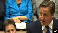 British Prime Minister David Cameron announces the UN resolution in parliament on June 8.