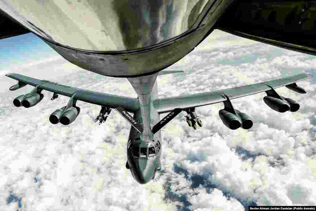 "An Air Force B-52 Stratofortress refueling during a bombing mission over Syria in February 2017. After the regime-aligned forces attacked the Kurdish base, American aircraft and artillery were used to pummel the attackers. At least dozens were killed in the ""inferno,"" including many Russian mercenaries."