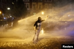 A police water cannon sprays a protester in Hamburg on July 6.