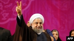 Iranian President Hassan Rohani gestures during a campaign rally in Tehran, May 9, 2017