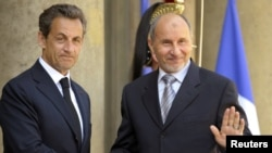 France -- President Nicolas Sarkozy (L) greets Mustafa Abdel Jalil, head of the main Libyan rebel council, as he arrives for a meeting in Paris, 20Apr2011