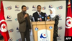 Members of the Islamist Ennahda party address the media and supporters in Tunis on October 24.
