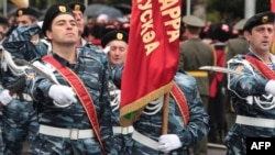 Abkhaz troops march in a military parade to mark the 20th anniversary of Abkhazia's de facto independence in the region's capital, Sukhumi, in September 2013.