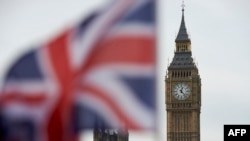 U.K. -- A Union flag flies in the wind in front of the Big Ben clock face and the Elizabeth Tower at the Houses of Parliament in central London, November 3, 2016