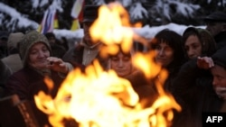 Georgia -- Supporters of South Ossetia's presidential candidate Alla Dzhioyeva warm up near a fire during a rally in Tskhinvali, 01Dec2011