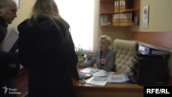 RFE/RL Ukrainian Service journalist Katerina Kaplyuk, attempting to interview an official of the Chabany village council near Kyiv, 6 March 2019.