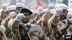 Members of Iran's elite Revolutionary Guards march in a military parade in 2008.