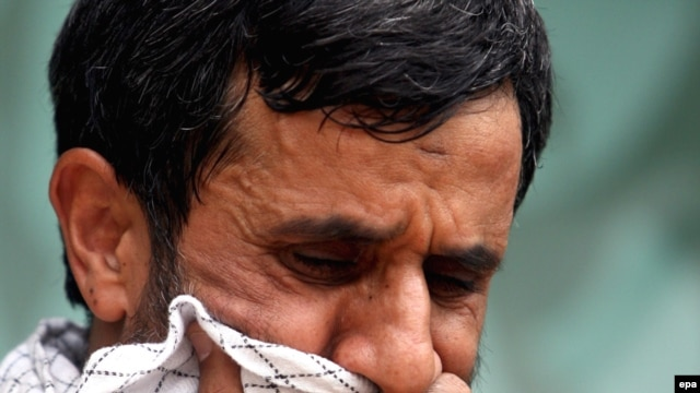 Iranian President Mahmud Ahmadinejad cries as he attends a mourning ceremony in Tehran in May 2009.