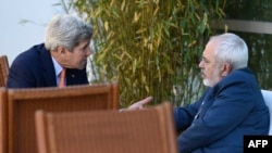 U.S. Secretary of State John Kerry (left) talks with Iranian Foreign Minister Mohammad Javad Zarif on May 30 in Geneva.