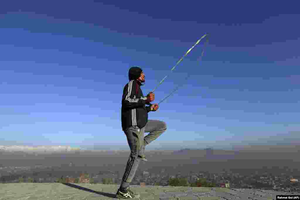 An Afghan youth exercises in the early morning on a hilltop in Kabul. (AP/Rahmut Gul)