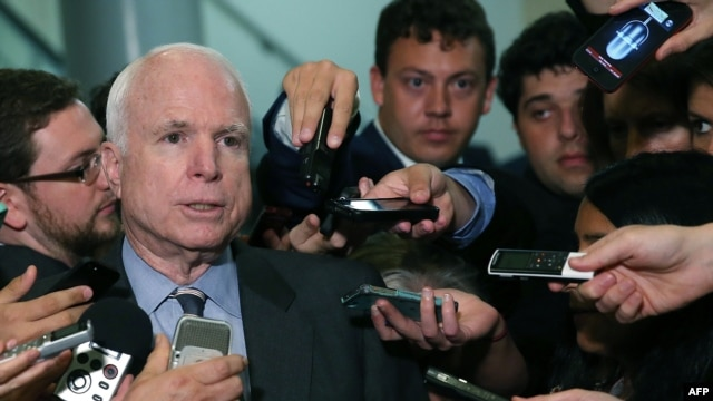 U.S. Senator John McCain (Republican-Arizona) talks to reporters after leaving a closed-door meeting about Syria at the U.S. Capitol on September 4 in Washington, D.C.