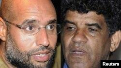 Сын Муамара Каддафи Сейф аль-Ислам и бывший глава разведслужбы Ливии Абдулла аль-Сенусси