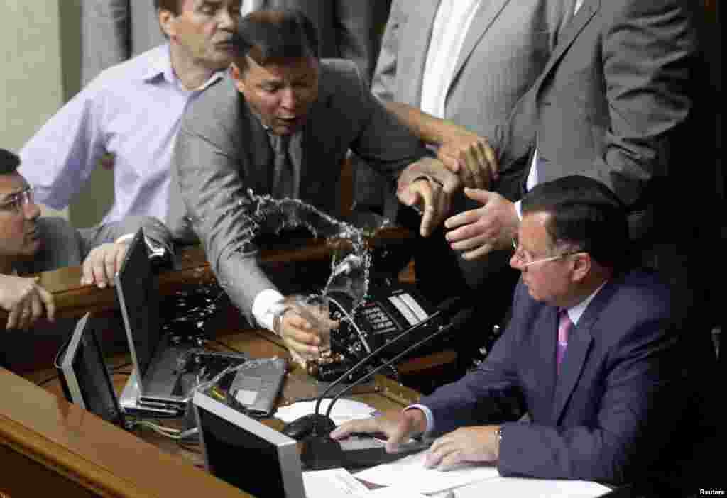 One year later, Lyashko took hot, sweet revenge when he doused Adam Martynyuk with tea. There's no word on the fate of that laptop.