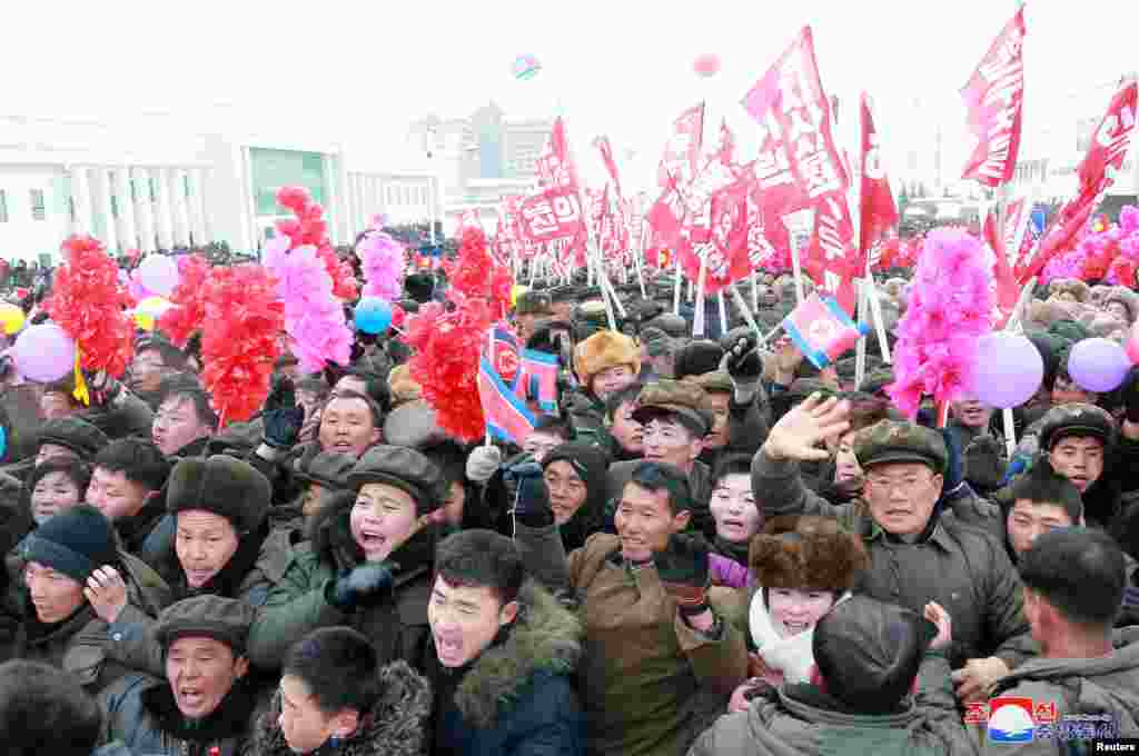 "Cheering crowds at the December 2 festivities. According to Reuters, Samjiyon was built using unpaid ""youth labor brigades"" which ""are forced to work more than 12 hours a day for up to 10 years in return for better chances to enter a university or join the all-powerful Workers' Party."""