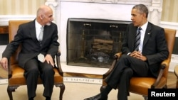 U.S. President Barack Obama (R) with Afghan President Ashraf Ghani in the Oval Office at the White House in Washington. (March 24, 2015)