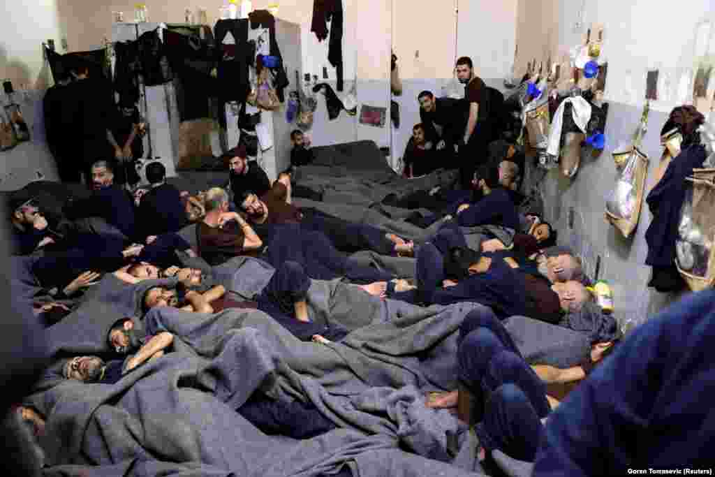 Suspects lie in a prison cell in Hasaka, Syria.